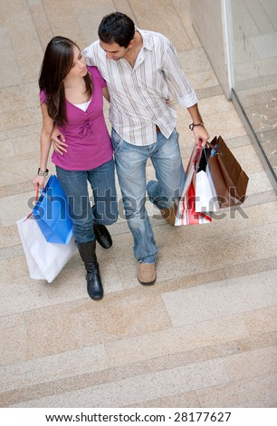 Couple on a shopping centre with bags