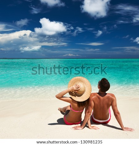 Couple on a tropical beach at Maldives #130981235