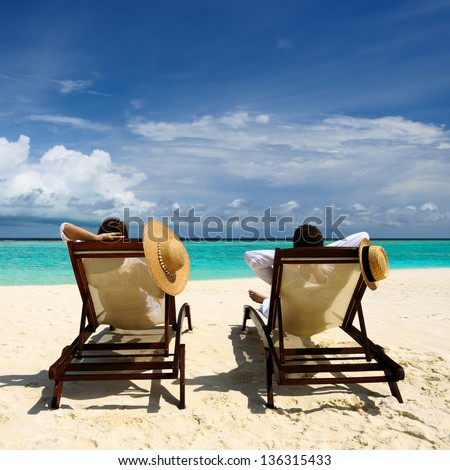 Couple on a tropical beach at Maldives #136315433