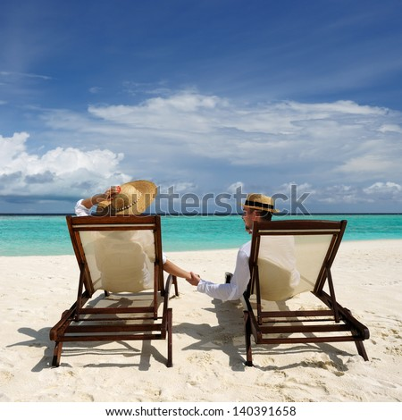 Couple on a tropical beach at Maldives #140391658