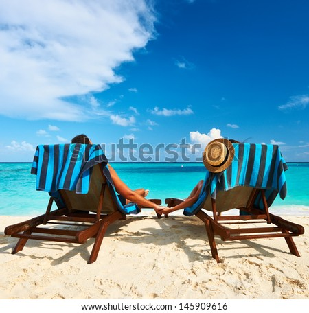 Couple on a tropical beach at Maldives #145909616