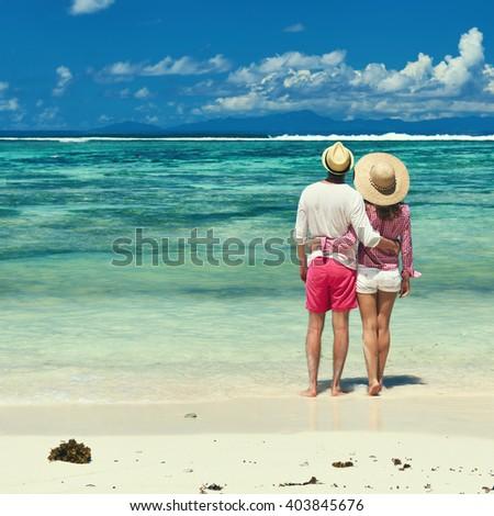 Couple on a tropical beach at Seychelles #403845676