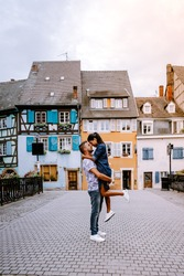 couple on city trip Colmar, Alsace, France. Petite Venice, water canal and traditional half timbered houses. Colmar is a charming town in Alsace, France. Beautiful view of colorful romantic city