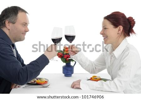 Couple on dinner clinking wine glasses