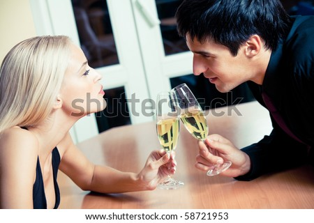 Couple on romantic date or celebrating together at restaurant