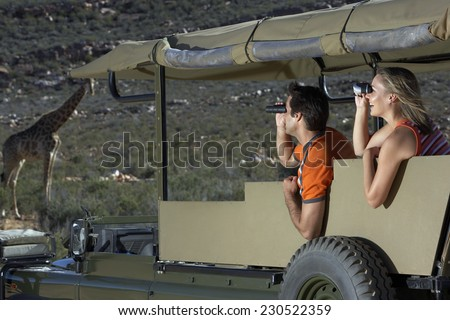 Couple on Safari Watching Giraffes