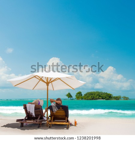 Couple on the beach in Bali Indonesia on their honeymoon #1238201998