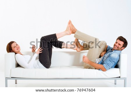 couple on the couch feet against feet