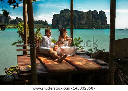 Couple on their honeymoon. Couple travels the world. Happy couple on vacation. Man and woman traveling to Thailand. Holidays on beautiful Islands. Tourists on vacation. Trip to the islands