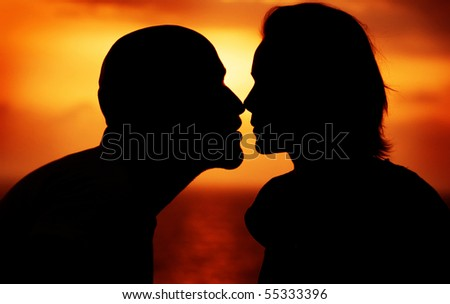 Couple over sunset background