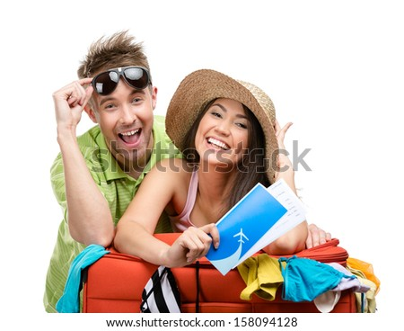 Couple packs up suitcase with clothing for departure isolated on white Concept of romantic vacations and lovely honeymoon