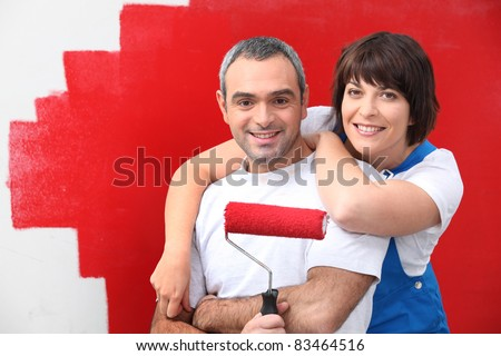 Stock Photo couple painting room in red