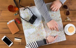 Couple planning trip to Munich, Germany, pointing on this city on map. Travel background with accessories