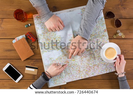 Couple planning trip to Paris, france, pointing on this city on map. Travel background with accessories - Shutterstock ID 726440674