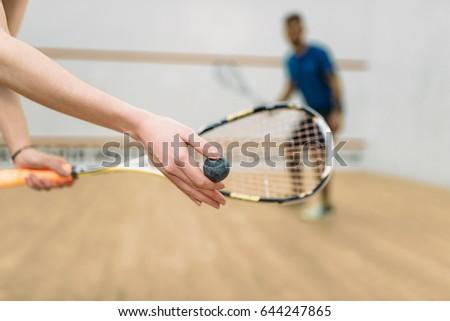 Couple play squash game in indoor training club ストックフォト ©