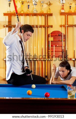 couple playing billiard expertise teacher and beautiful girl