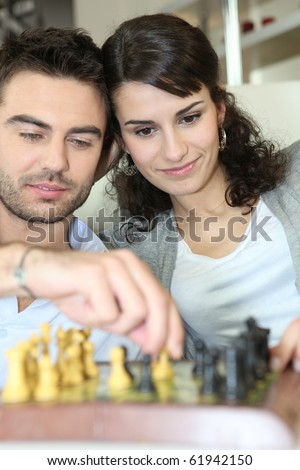 Couple playing chess - stock photo