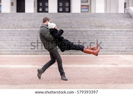 couple playing outside #579393397