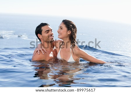 Couple playing together in a swimming pool