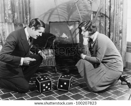 Couple playing with huge dice