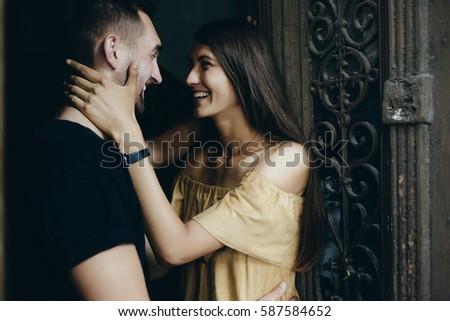 couple posing in the doorway posing on camera #587584652