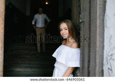 couple posing in the doorway posing on camera #646905061