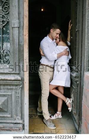 couple posing in the doorway posing on camera #652223617