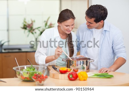 Couple preparing a sauce in their kitchen