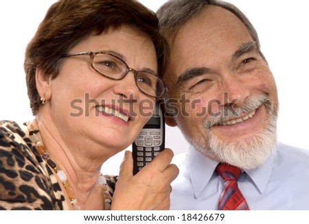 Couple receiving good news over the phone