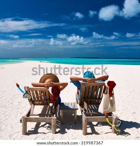 Couple relax on a tropical beach at christmas #319987367