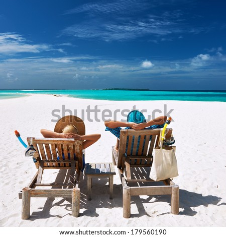 Couple relax on a tropical beach at Maldives #179560190