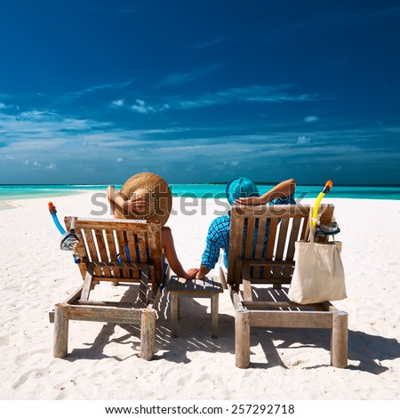 Couple relax on a tropical beach at Maldives #257292718