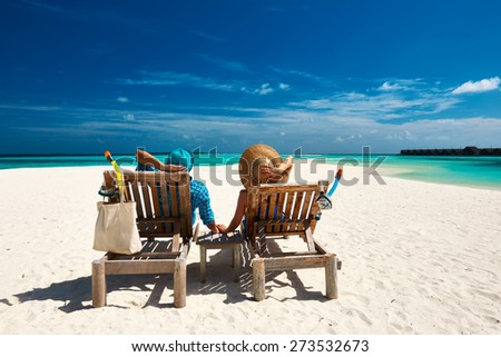 Couple relax on a tropical beach at Maldives #273532673