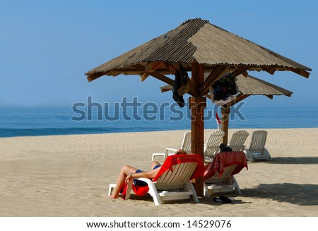 Couple Relaxes on Remote Beach