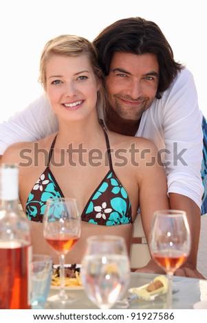 couple relaxing in a beach restaurant
