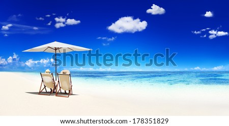 Couple Relaxing in Deck Chairs at Beach #178351829