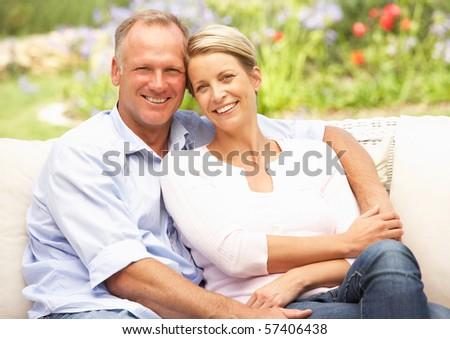 Couple Relaxing In Garden