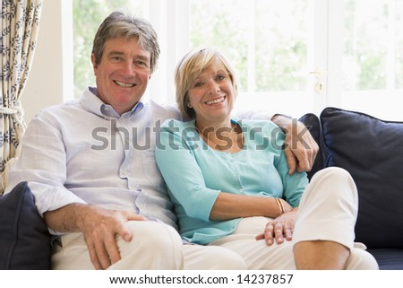 Couple relaxing in living room smiling #14237857