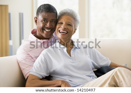 stock photo : Couple relaxing indoors and smiling