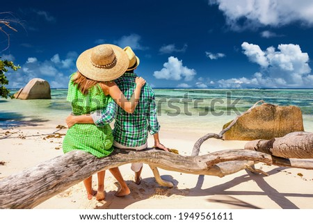 Couple relaxing on a tropical beach Anse Source d'Argent at Seychelles, La Digue.  Photo stock ©