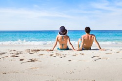 couple relaxing on paradise beach