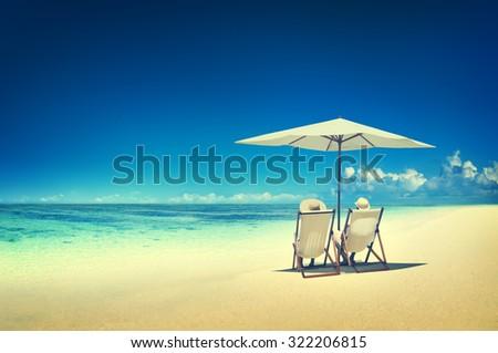 Couple Relaxing Tropical Beach Ocean Summer Travel Concept #322206815