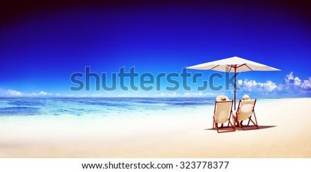 Couple Relaxing Tropical Beach Ocean Summer Travel Concept #323778377
