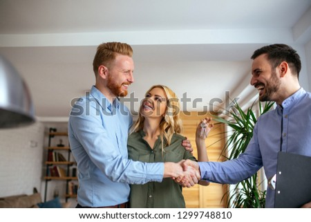 Couple renting apartment from agent