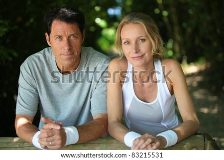Couple resting after exercise - stock photo