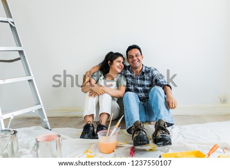Couple resting after painting the room Foto stock ©