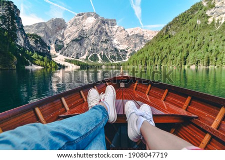 couple resting on boat at mountain lake. summer vacation