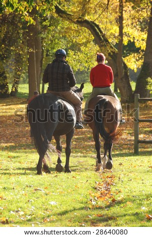 Couple riding in autumn forest