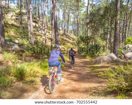 Couple riding mountain bikes in Sintra, Portugal. #702555442