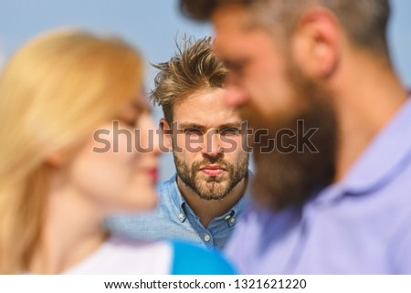 Couple romantic date lovers flirting. Couple in love happy dating, jealous man watching woman prefers another macho instead him. Lovers meeting outdoor flirt romance relations. Broken heart concept. #1321621220
